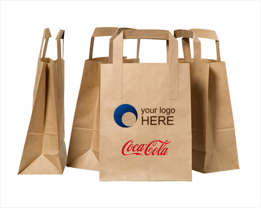 Four brown company bags with logo of Coca-Cola.