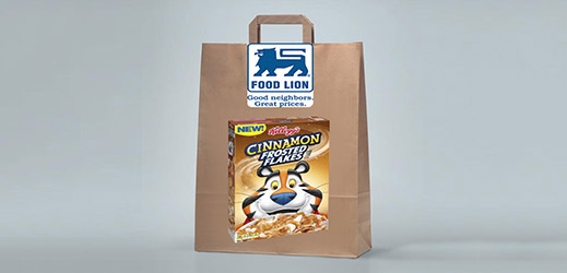 A brown recyclable grocery bag with an advertisement of Food Lion and Cinnamon Frosted Flakes.