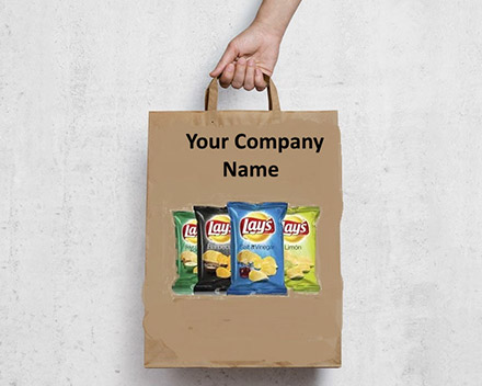 A hand holding a printed paper bag with an advertisement of Lay's chips company product and Your Company Name.
