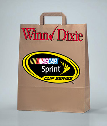 A grocery bag with handles printed with two brand names, Winn Dixie and NASCAR Sprint Cup Series.