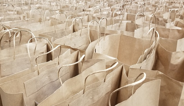 Lots of brown reusable shopping bags with handles.