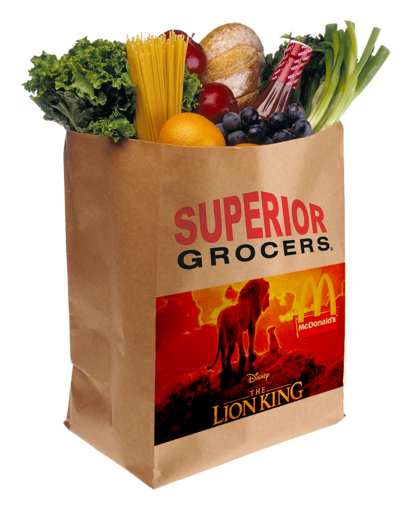 A recycling paper bag printed with brand names, and with fruits and vegetables placed inside.