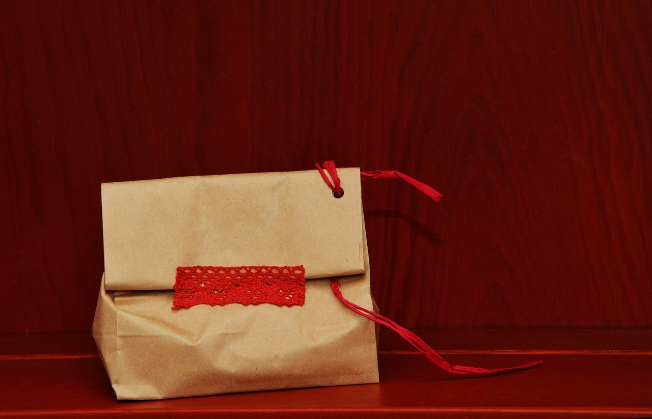 paper bag with red string